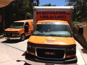 Water Damage Restoration Truck At Residential Job Location
