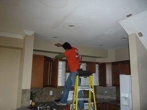911 Restoration Longview technician inspecting ceiling
