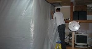 Water Damage Tech Sealing In Mold With A Vapor Barrier