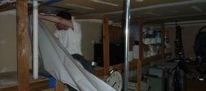 Water Damage Tigard Technician Removing Vapor Barrier