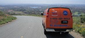 Water and Mold Damage Restoration Van Navigating To Job Location