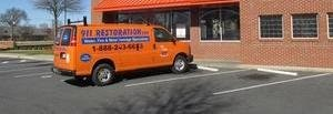 Water and Mold Damage Restoration Van Parked At Job