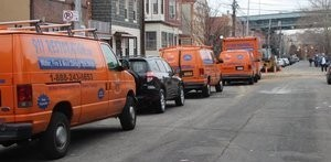 Water Damage Kalama Vans And Trucks Lined Up At Urban Job Location