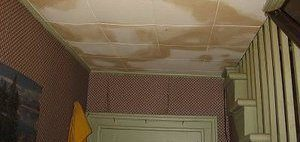 Water Damage On The Ceiling Of A Home After An Upstairs Flood